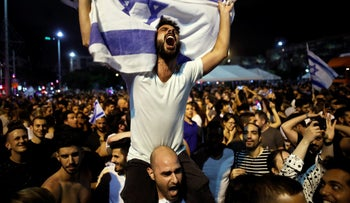 """People celebrate the winning of the Eurovision Song Contest 2018 by Israel's Netta Barzilai with her song """"Toy"""" ,at Rabin square in Tel Aviv Israel, May 13, 2018."""