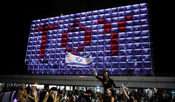 """People celebrate the winning of the Eurovision Song Contest 2018 by Israel's Netta Barzilai with her song """"Toy,"""" at Rabin square in Tel Aviv, May 13, 2018."""