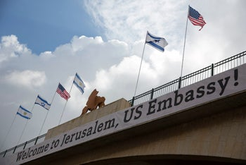 A sign on a bridge leading to the US Embassy compound ahead the official opening in Jerusalem, Sunday, May 13, 2018. Monday's opening of the U.S. Embassy in contested Jerusalem, cheered by Israelis as a historic validation, is seen by Palestinians as an in-your-face affirmation of pro-Israel bias by President Donald Trump and a new blow to frail statehood dreams.