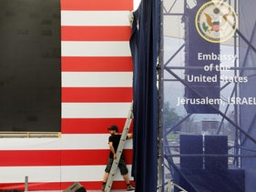 A worker is seen inside the new U.S. embassy compound during preparations for its opening ceremony, in Jerusalem, May 13, 2018