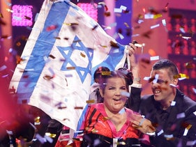 Netta from Israel celebrates after winning the Eurovision Song Contest grand final in Lisbon, Portugal, May 12, 2018.