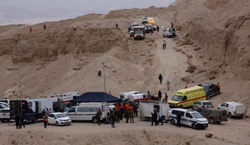 Search and rescue vehicles seen parked in the Negev desert where the 10 teens died during a hiking trip.
