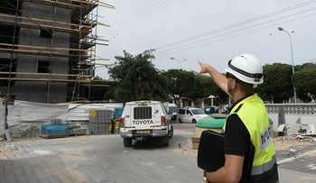 A Labor Ministry supervisor at a construction site in Ashdod.