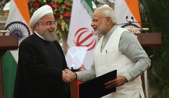 Indian Prime Minister Narendra Modi, right, shaking hands with Iranian President Hassan Rohani after the signing of an agreement in New Delhi, February 17, 2018.