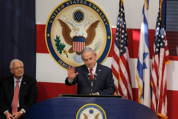 Israeli Prime Minister Benjamin Netanyahu speaks as U.S. Ambassador to Israel David Friedman listens during the opening ceremony of the new US embassy in in Jerusalem, Monday, May 14, 2018. Amid deadly clashes along the Israeli-Palestinian border, President Donald Trump's top aides and supporters on Monday celebrated the opening of the new U.S. Embassy in Jerusalem as a campaign promised fulfilled. (AP Photo/Sebastian Scheiner)