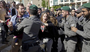 Demonstrators clashing with Israeli Border Police officers during a protest outside the new U.S. Embassy in Jerusalem, May 14, 2018.