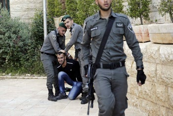 Israeli Border Police officers detaining a demonstrator during the protest outside the new U.S. Embassy in Jerusalem, May 14, 2018.