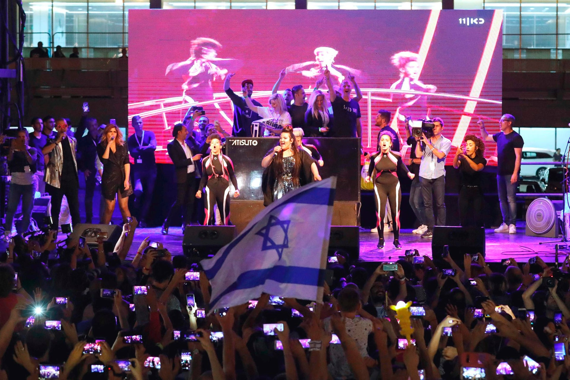 Israel's Netta Barzilai performs on stage a festive welcome concert in the Israeli coastal city of Tel Aviv on May 14, 2018 after winning the Eurovision Song Contest on Sunday in Lisbon, Portugal.