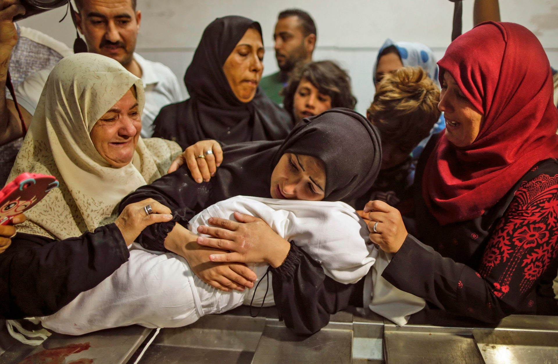 The mother of a Leila al-Ghandour, a Palestinian baby of 8 months who died Monday. Both Gaza health officials and Israeli officials cast doubts on claims she dies of tear gas inhalation
