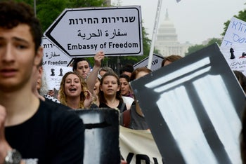 Members of IfNotNow and rabbinical school students blocking traffic while protesting the U.S. Embassy move to Jerusalem and Israeli violence against Palestinians in Gaza, Washington, May 14, 2018.