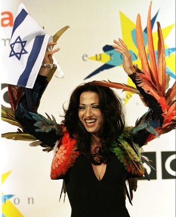 Dana International celebrates her Eurovision victory in 1998. Chicken wings courtesy of Jean Paul Gaultier.