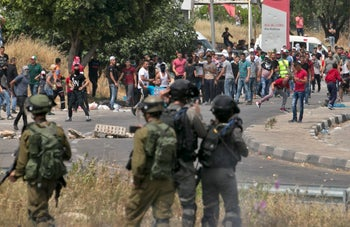 "Palestinians clash with Israeli security forces after a protest marking Nakba, or ""catastrophe"", at the Hawara checkpoint south of Nablus on May 15, 2018"