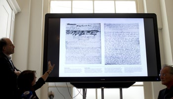 The two recovered pages from Anne Frank's diary in display in Amsterdam.