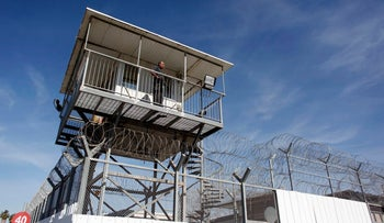 An Israeli prison guard keeps watch from a tower at Ayalon prison in Ramle near Tel Aviv February 13, 2013