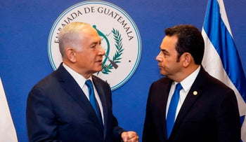 Israeli Prime Minister Benjamin Netanyahu (L) speaks with Guatemalan President Jimmy Morales ahead of the inauguration ceremony of Guatemala's embassy in Jerusalem on May 16, 2018.