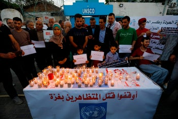 Palestinians light memorial candles and call for the end of the killing of Palestinians during protests on the Gaza-Israel border. UNESCO headquarters in Gaza City, May 16, 2018