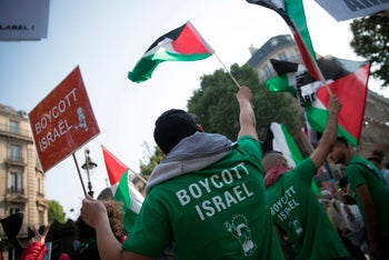 Protestors wave Palestinian flags as they demonstrate in Paris against the U.S. embassy opening and Gaza killings. May 15, 2018