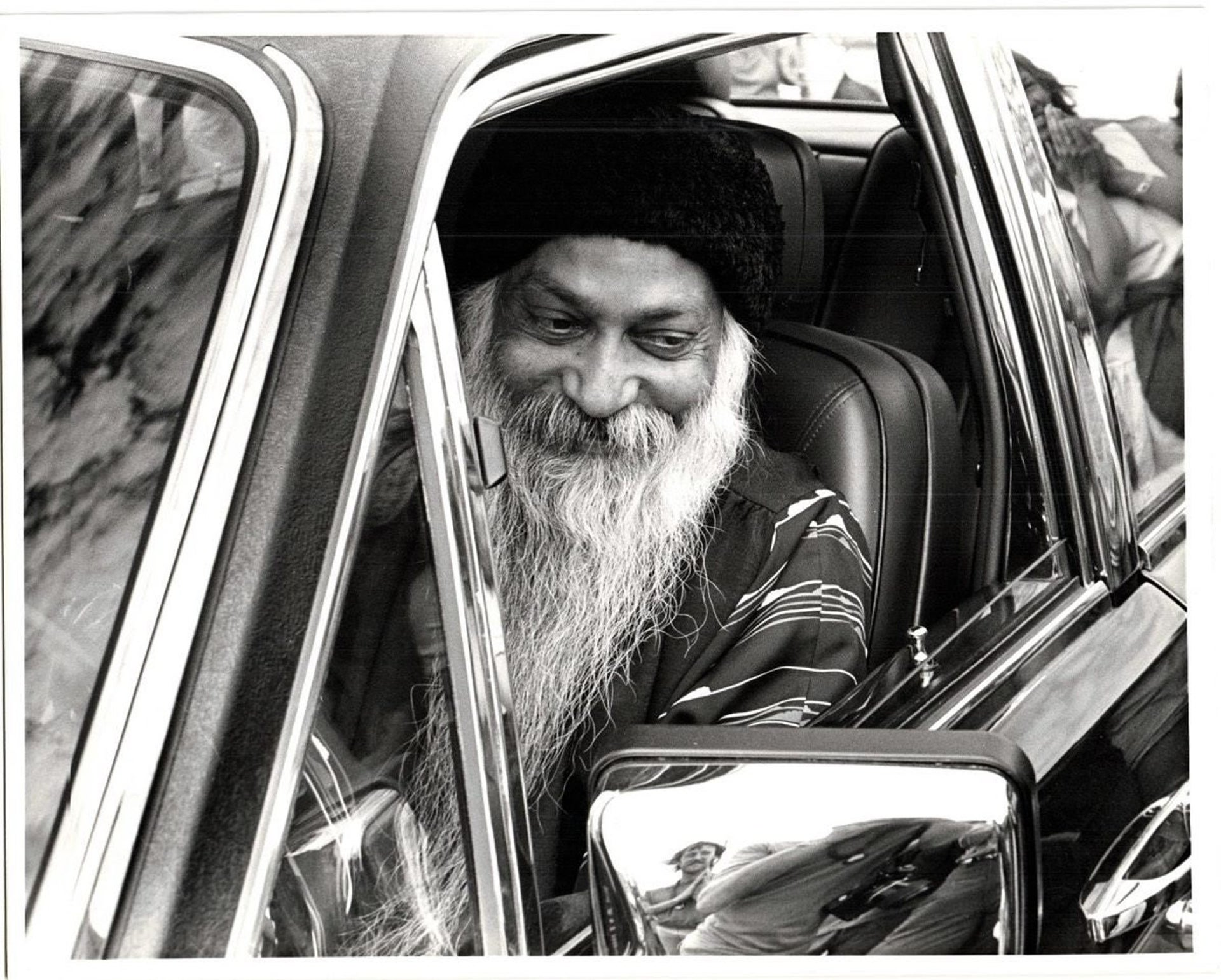 Osho in one of his tens of Rolls-Royces.