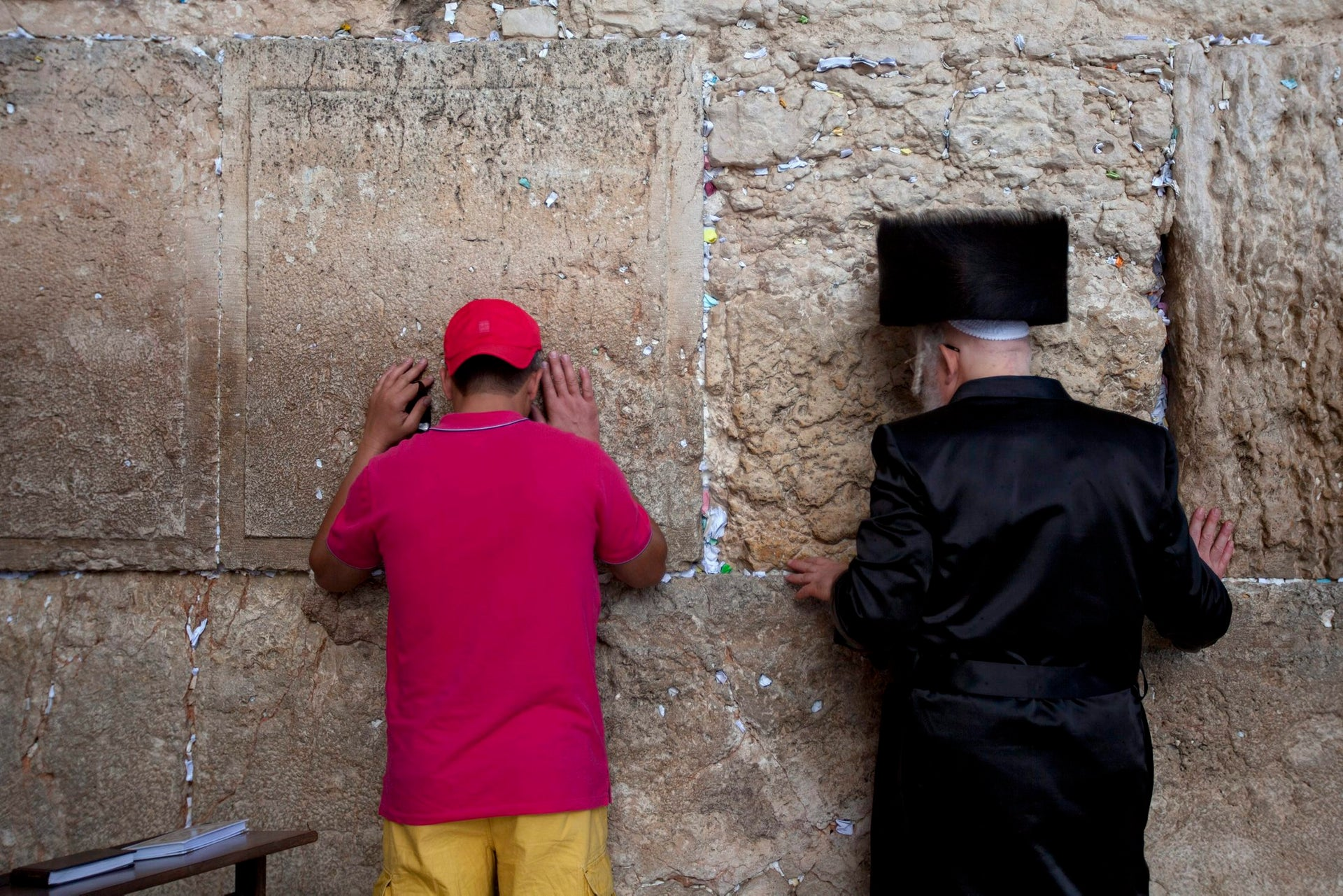 An Orthodox Jew, right, and a non-Orthodox praying at the Western Wall, the last remnant of the wall surrounding the Second Temple Courtyard