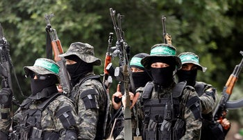 Palestinian Hamas militants attend the funeral of their comrade Mahmoud al-Qeshawi, killed in an explosion in Gaza city May 6, 2018.