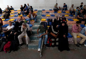 Palestinians wait to travel to Egypt through the Rafah border crossing, in the southern Gaza Strip May 18, 2018