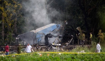 Investigators work near the remains of a Boeing 737 that crashed in Havana, Cuba, Friday, May 18, 2018.