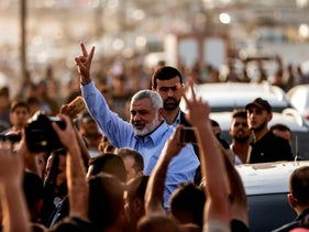 Hamas leader Ismail Haniyeh gestures to demonstrators at the Gaza fence, May 18, 2018.