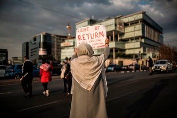 Members of pro-Palestinian and other civil society groups demonstrate outside the US Consulate General in Johannesburg, South Africa, during a protest to mark Nakba Day. May 15, 2018