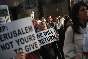 Members of the Palestinian community and supporters march toward the Israeli consulate to protest the U.S. embassy move to Jerusalem. Chicago, Illinois, May 15, 2018