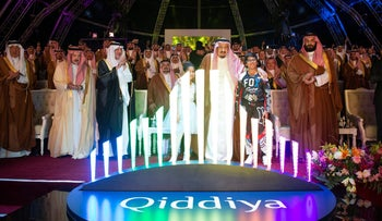 Saudi Arabia's King Salman bin Abdulaziz Al Saud, center, and Crown Prince Mohammed bin Salman, right, attending the launch ceremony of a multibillion dollar entertainment resort in Riyadh, April 28, 2018.