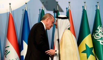 Turkish President Tayyip Erdogan and The Secretary General of The OIC Yousef Ahmed Al-Othaimeen embrace at a summit of the OIC in Istanbul, May 19, 2018.