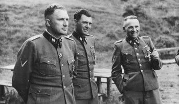 SS officer and Auschwitz doctor Joseph Mengele (center) in 1944, socializing at an SS retreat outside the camp with Auschwitz commandant Richard Baer and former commandant Rudolf Hoess.