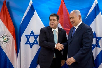 Israeli Prime Minister Benjamin Netanyahu, right, shakes hands with Paraguay's President Horacio Cartes during their meeting at the Prime Minister's office in Jerusalem, Monday, May 21, 2018. Paraguay opened its new embassy in Jerusalem on Monday, following in the footsteps of the United States and Guatemala.