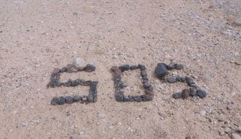 The SOS spelled with desert rocks that helped police find the missing couple, May 22, 2018.