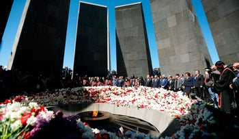 Armenian officials at the monument to the victims of mass killings by Ottoman Turks, Yerevan, Armenia, April 24, 2018