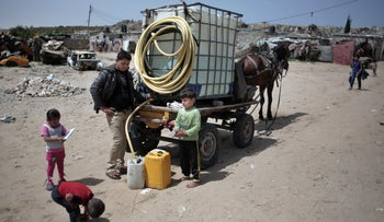 A Palestinian man sells drinking water in Khan Younis refugee camp, southern Gaza Strip, April 16, 2016