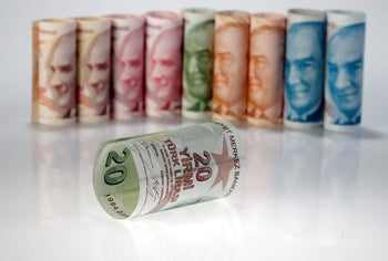 FILE PHOTO: Turkish Lira banknotes are seen in this October 10, 2017 picture illustration.