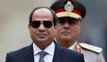 FILE PHOTO- In this October 24, 2017 photo, Egyptian President Abdel-Fattah el-Sissi attends a military ceremony in the courtyard at the Hotel des Invalides in Paris, France.
