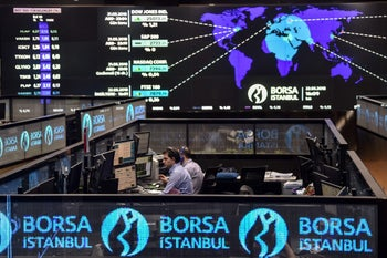 Traders working at their desks on the floor of the Borsa Istanbul, May 22, 2018.
