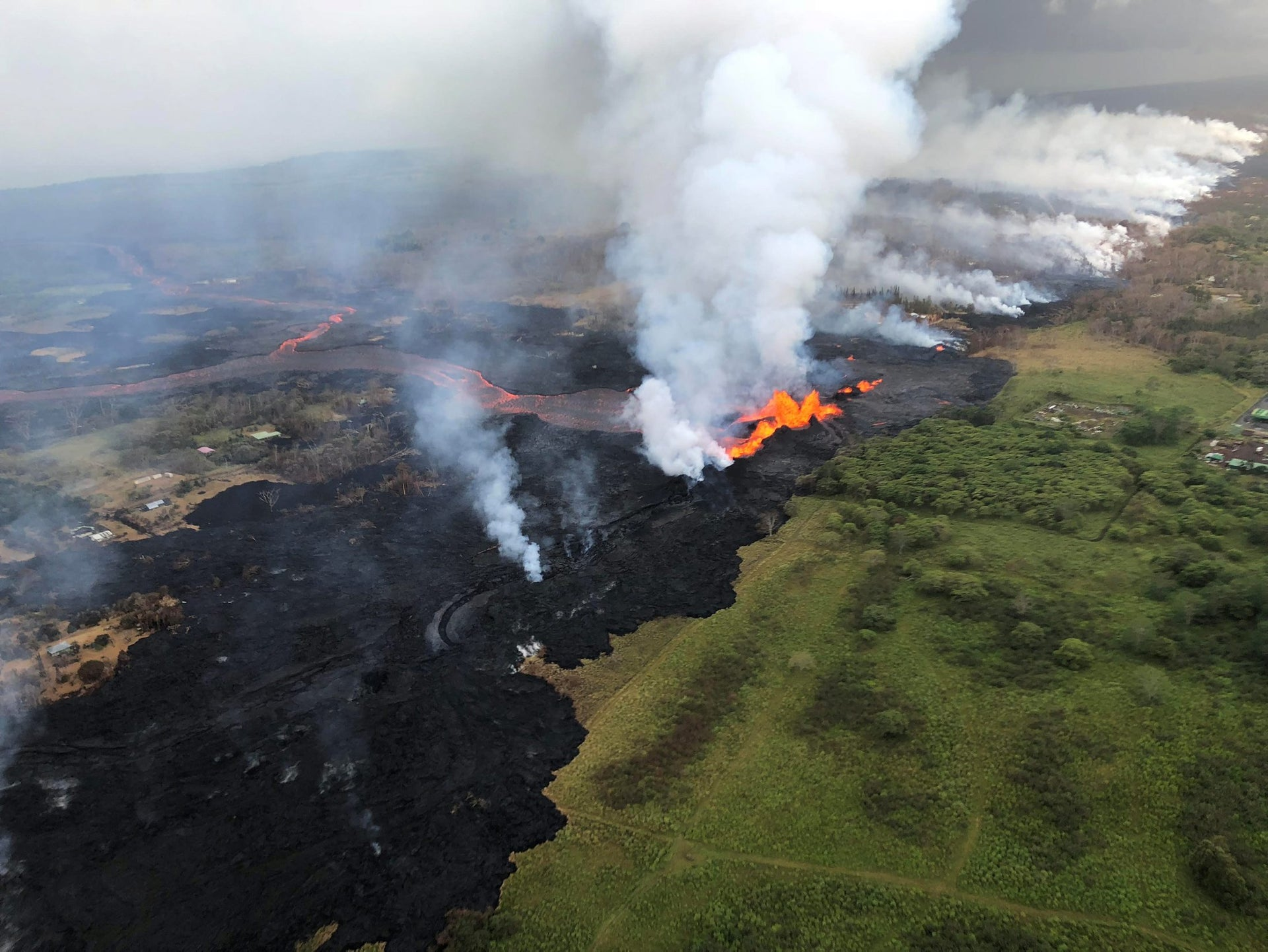 Lava from Fissue 22 of Kilauea approaches the Ormat power station called Puna