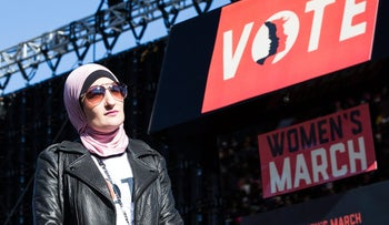Linda Sarsour, co-chair for the Women's March, listens during the Women's March One-Year Anniversary: Power To The Polls event in Las Vegas, Nevada, U.S., on Sunday, Jan. 21, 2018. On the anniversary of the Women's March, the Power to the Polls rally aims at a tighter objective, to launch a national voter registration and mobilization tour with a goal to elect more women and progressive candidates to public office. Photographer: Michelle Gustafson/Bloomberg