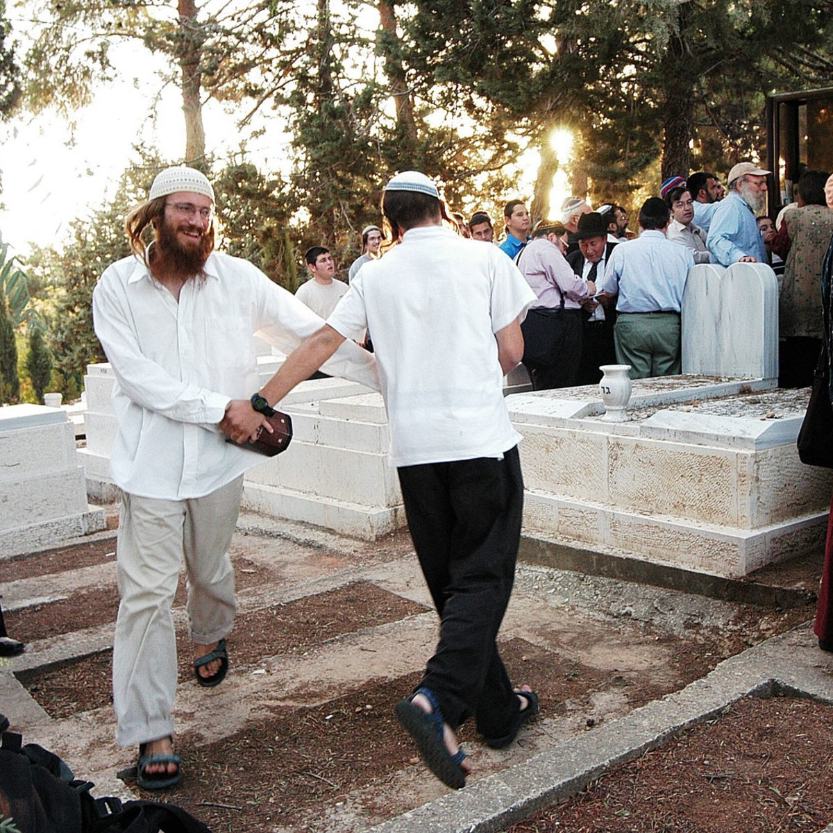Carlebach acolytes visiting his grave in Jerusalem.