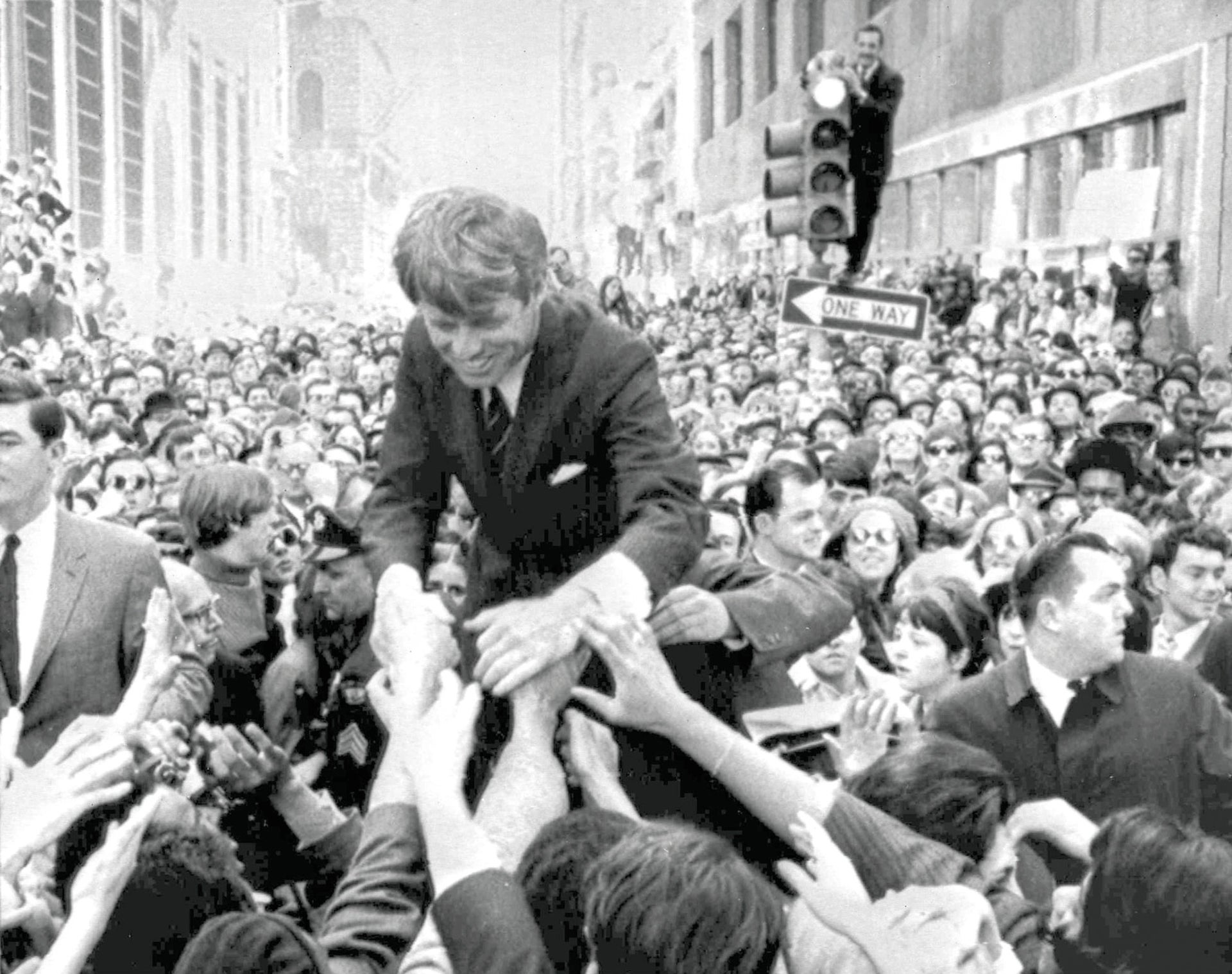 U.S. Sen. Robert F. Kennedy shakes hands with people in a crowd while campaigning for the Democratic party's presidential nomination in Philadelphia, April 2, 1968.