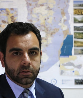 FILE PHOTO - Human Rights Watch's Israel and Palestine director Omar Shakir, a US citizen, sits at his office in the West Bank city of Ramallah on May 9, 2018.
