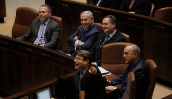 Israeli Prime Minister Benjamin Netanyahu, center left, sits with Minister of Public Security Gilad Erdan, left, during a session at the Knesset in Jerusalem, Monday, March 12, 2018