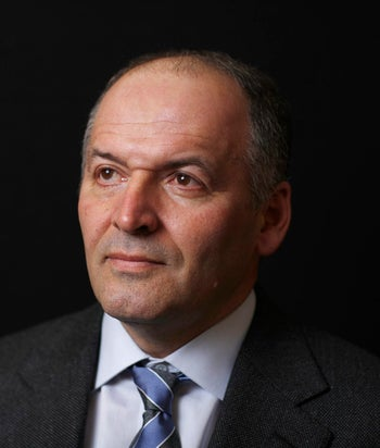 Ukrainian billionaire Victor Pinchuk, founder of Interpipe Group, poses for a photograph following a Bloomberg Television interview on day two of  the World Economic Forum (WEF) in Davos, Switzerland, on Thursday, Jan. 24, 2013. World leaders, influential executives, bankers and policy makers attend the 43rd annual meeting of the World Economic Forum in Davos, the five day event runs from Jan. 23-27. Photographer: Simon Dawson/Bloomberg