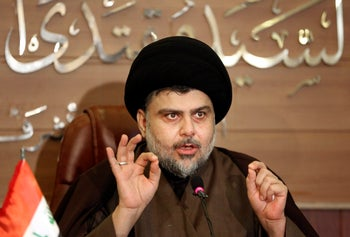 Shi'ite cleric Muqtada al-Sadr speaks during a press conference in Najaf