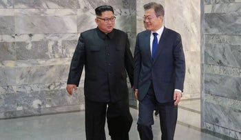 South Korea's President Moon Jae-in walking with North Korea's leader Kim Jong Un for their second summit at the north side of the truce village of Panmunjom in the Demilitarized Zone, May 26, 2018