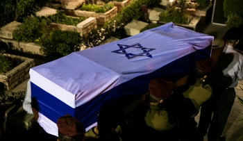 Soldiers bearing the coffin of Staff. Sgt. Ronen Lubarsky at the funeral Saturday night.