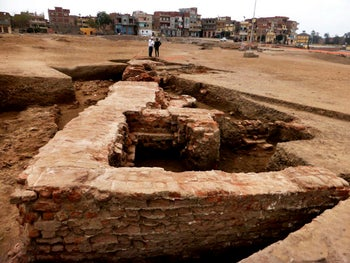 Parts of a huge red brick building dating back to the Greco-Roman period, in the San El-Hagar archaeological site in Gharbia province, north of Cairo, Egypt. Egyptian archeologists said they have found a gold coin depicting King Ptolemy III, who ruled Egypt in the 3rd century B.C. and was an ancestor of the famed Cleopatra and other artifacts in the area, including pottery vessels, terracotta statues, bronze tools and a small statue of a ram.